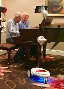 Residents enjoying the piano playing in the lobby at The Heritage Downtown