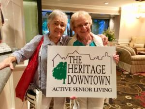 The Heritage Downtown residents holding a THD sign