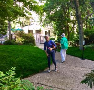 A couple of residents walking through The Heritage Downtown property