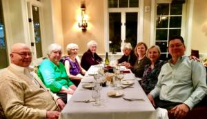 Image of residents at dinner table at The Heritage Downtown