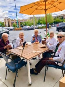 Outdoor dining in Walnut Creek, with several residents of The Heritage Downtown